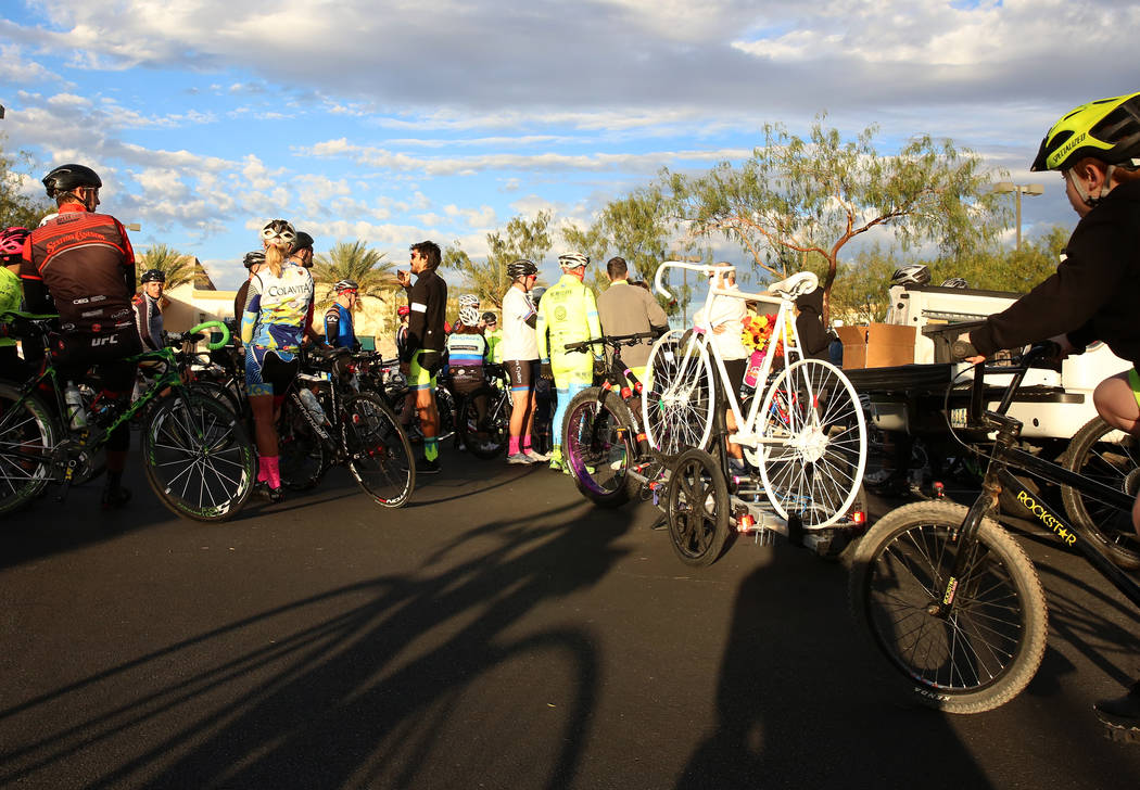Bikers gather around the ghost bike of Cara Cox as they prepare for a ghost bike memorial ceremony on Saturday, Nov. 4, 2017, in Henderson. Cox was struck by a vehicle while riding her bike on Oct ...