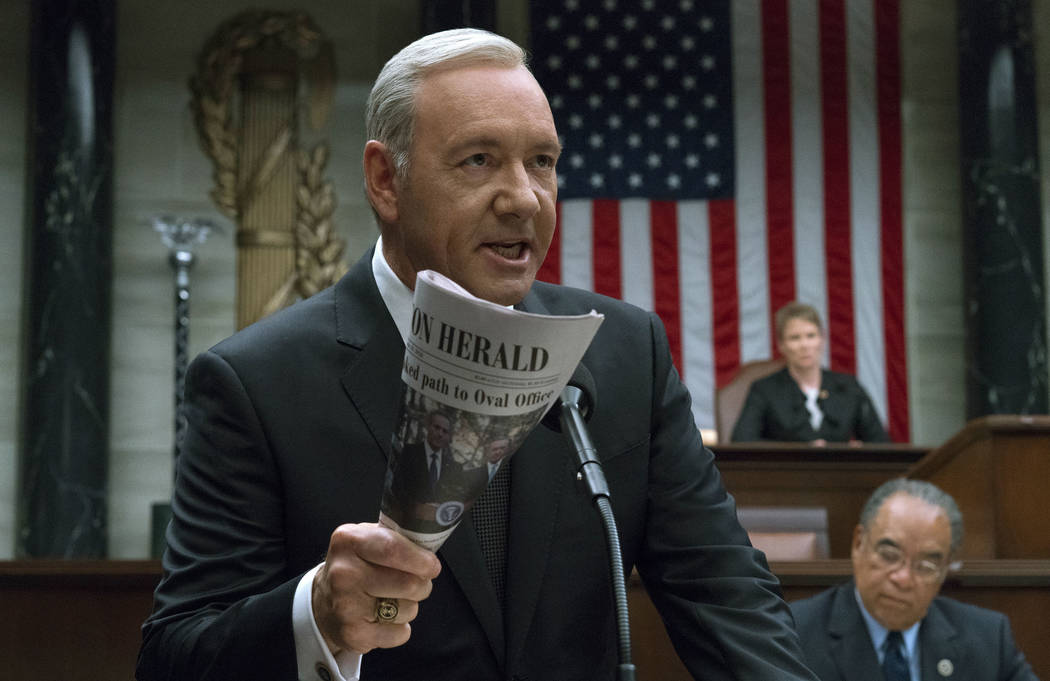"""This image released by Netflix shows Kevin Spacey in a scene from """"House Of Cards."""" Netflix says it's suspending production on """"House of Cards"""" following harass ..."""
