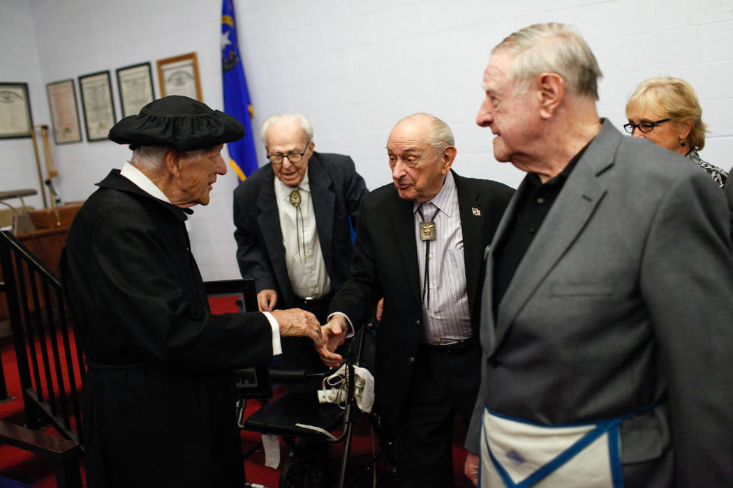 Edward Hall, 93, a WWII veteran and Pearl Harbor attack survivor, left, greets Frank Zeigler, 83, second from left, Art Castle, 89, second from right, and Albert Tyson, right, all members of Dayli ...