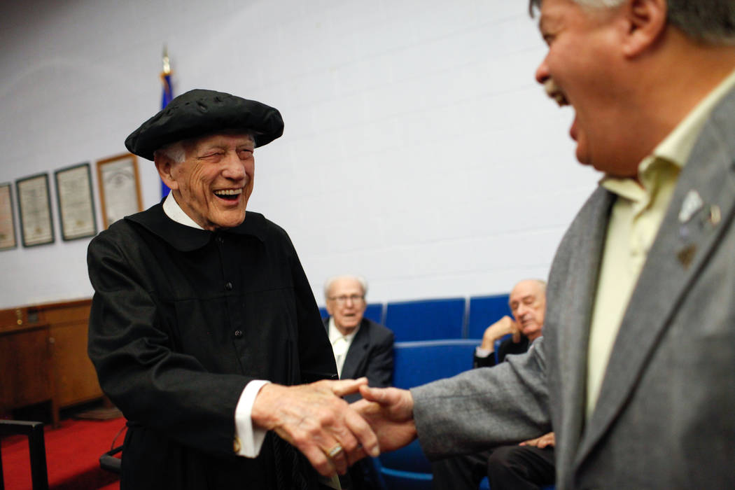 Edward Hall, 93, a WWII veteran and Pearl Harbor attack survivor, left, greets friends after receiving his high school diploma during a ceremony at the Masonic Memorial Temple in Las Vegas, Monday ...