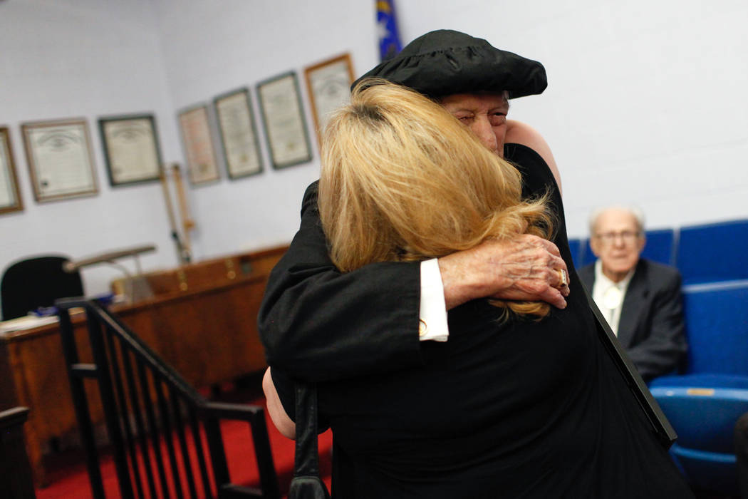Edward Hall, 93, a WWII veteran and Pearl Harbor attack survivor, hugs his step-daughter Nicole Hines, 60, after receiving his high school diploma during a ceremony at the Masonic Memorial Temple  ...