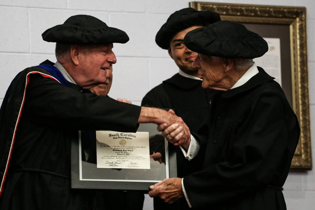 Bob Taylor, secretary of the Scottish Rite Las Vegas Valley, left, presents Edward Hall, 93, a WWII veteran and Pearl Harbor attack survivor, right, with his high school diploma during a ceremony  ...