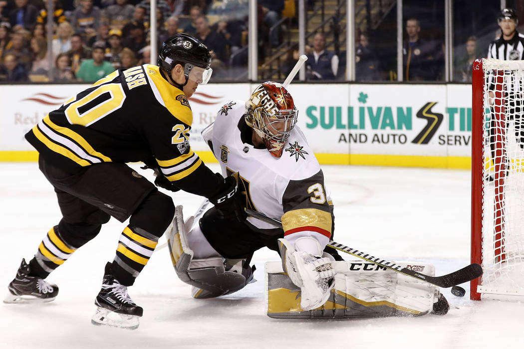 Boston Bruins' Riley Nash, left, cannot get the puck past Vegas Golden Knights goalie Maxime Lagace during the second period of an NHL hockey game in Boston, Thursday, Nov. 2, 2017. (AP Photo/Wins ...