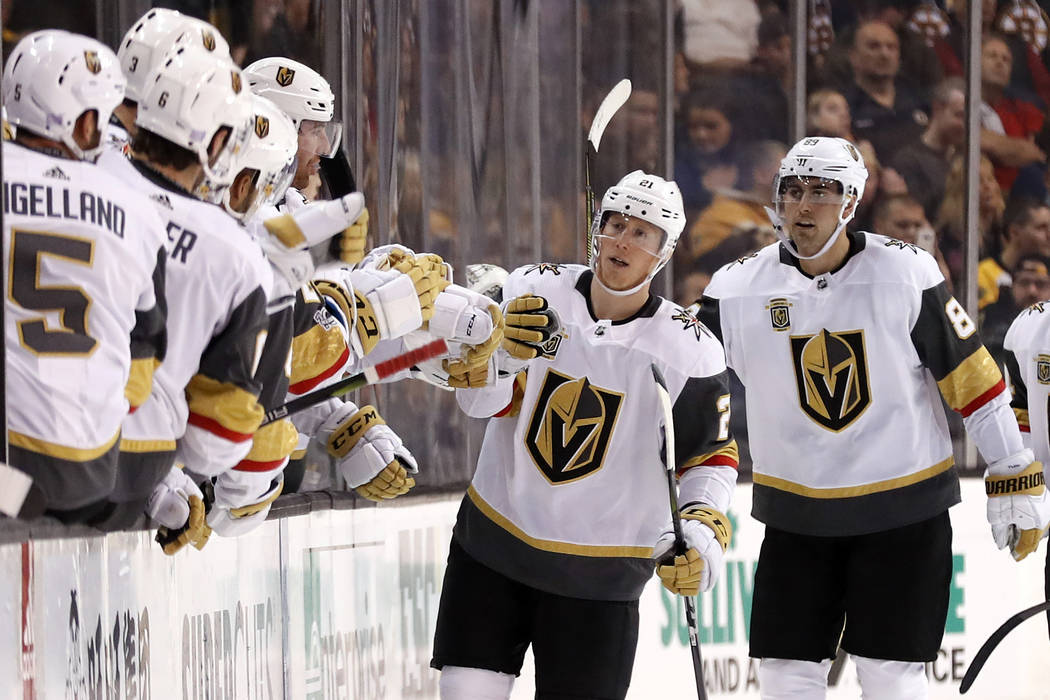 Vegas Golden Knights' Cody Eakin is congratulated at the bench after scoring against the Boston Bruins during the second period of an NHL hockey game in Boston, Thursday, Nov. 2, 2017. (AP Photo/W ...