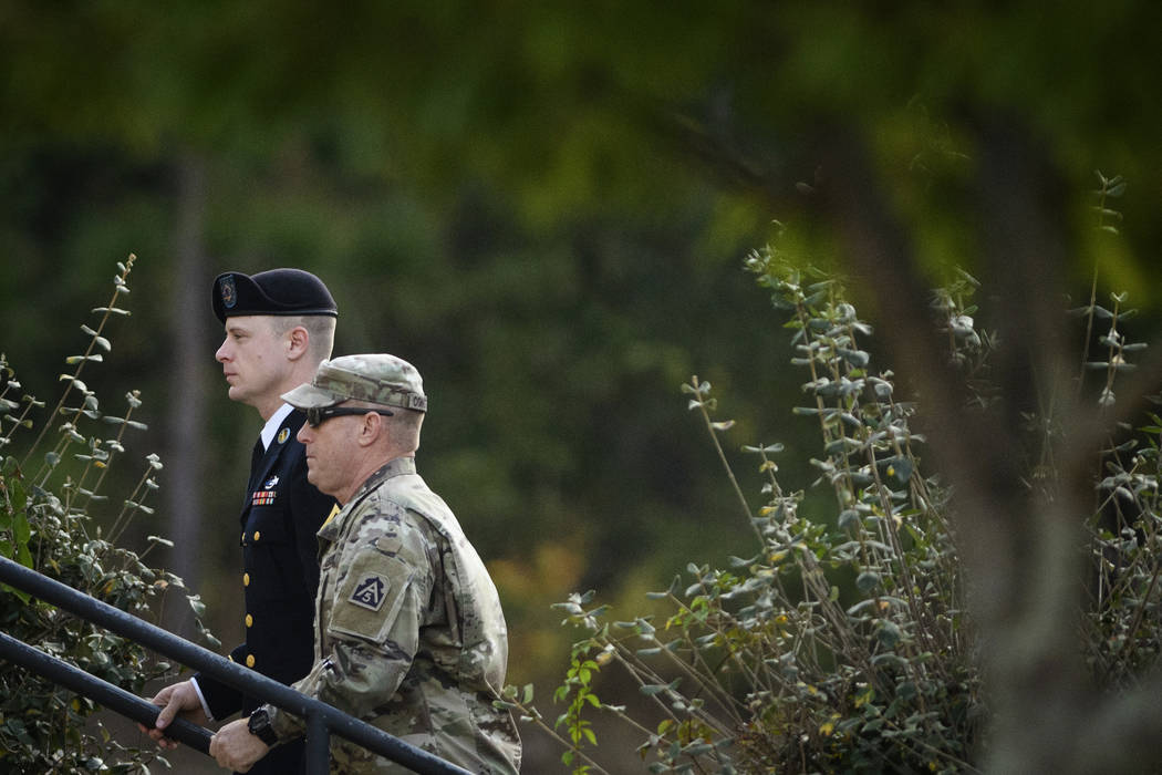 Army Sgt. Bowe Bergdahl, left, arrives at the Fort Bragg courtroom facility for a sentencing hearing on Wednesday, Nov. 1, 2017, on Fort Bragg, N.C. Bergdahl, who walked off his base in Afghanista ...