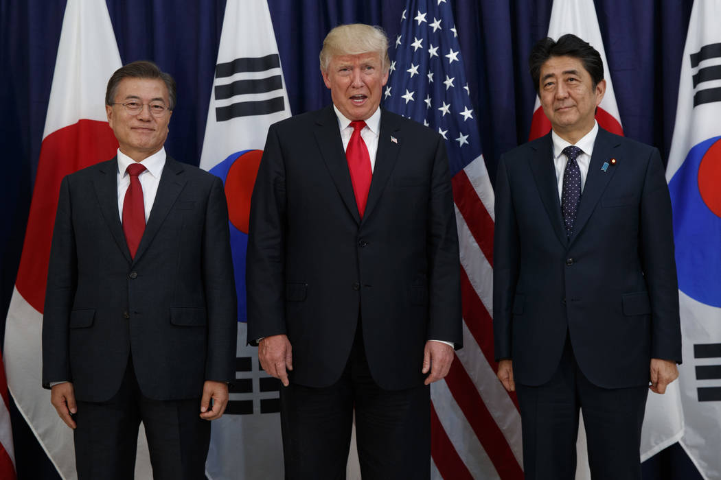 In this July 6, 2017 file photo, President Donald Trump meets with Japanese Prime Minister Shinzo Abe, right, and South Korean President Moon Jae-in before the Northeast Asia Security dinner at th ...