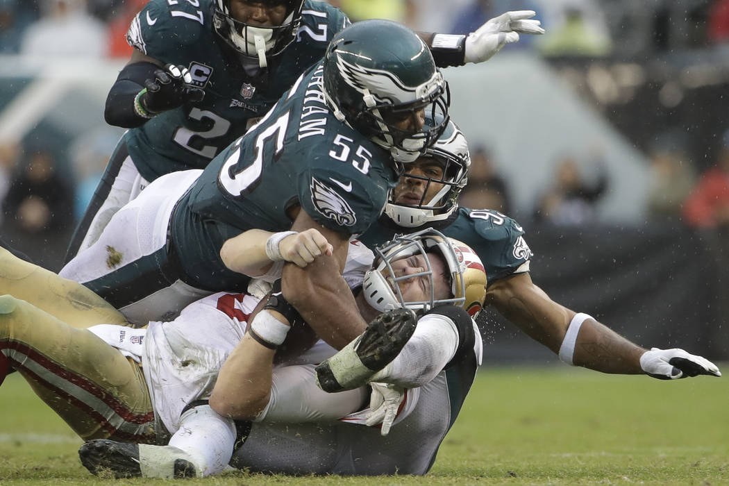 San Francisco 49ers' C.J. Beathard (3) is sacked by Philadelphia Eagles' Brandon Graham (55) and Mychal Kendricks (95) during the second half of an NFL football game, Sunday, Oct. 29, 2017, in Phi ...