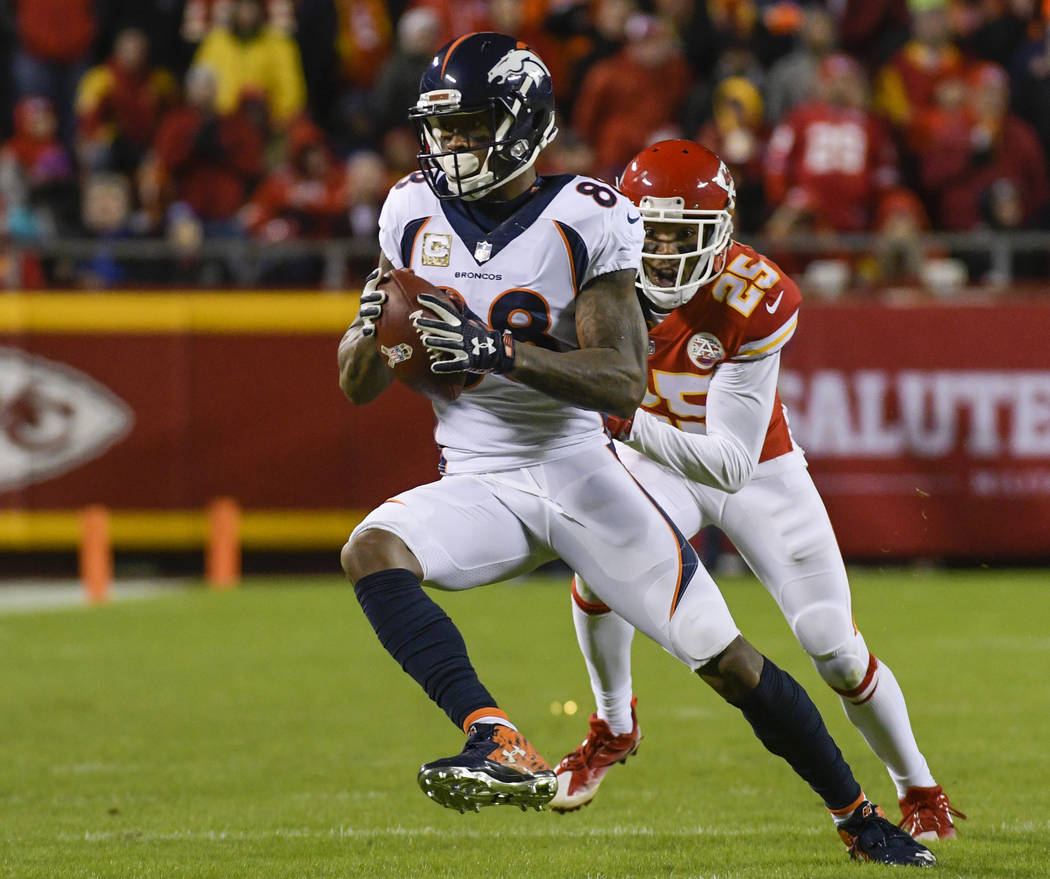 Denver Broncos wide receiver Demaryius Thomas (88) makes a catch in front of Kansas City Chiefs cornerback Kenneth Acker (25) during the second half of an NFL football game in Kansas City, Mo., Mo ...