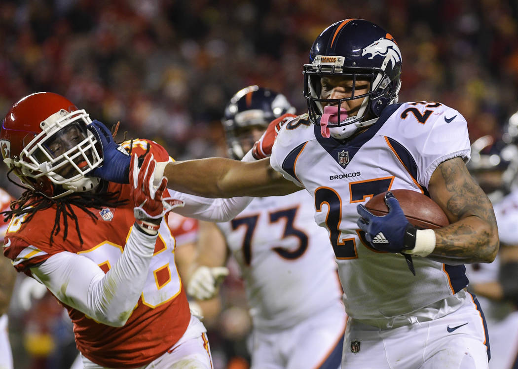 Denver Broncos running back Devontae Booker (23) runs against Kansas City Chiefs free safety Ron Parker (38) during the second half of an NFL football game in Kansas City, Mo., Monday, October 30, ...