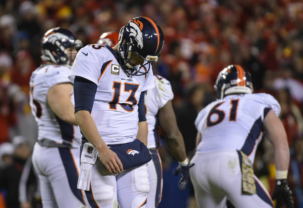 Denver Broncos quarterback Trevor Siemian (13) walks to the sidelines after calling a time-out during the second half of an NFL football game in Kansas City, Mo., Monday, October 30, 2017. (AP Pho ...
