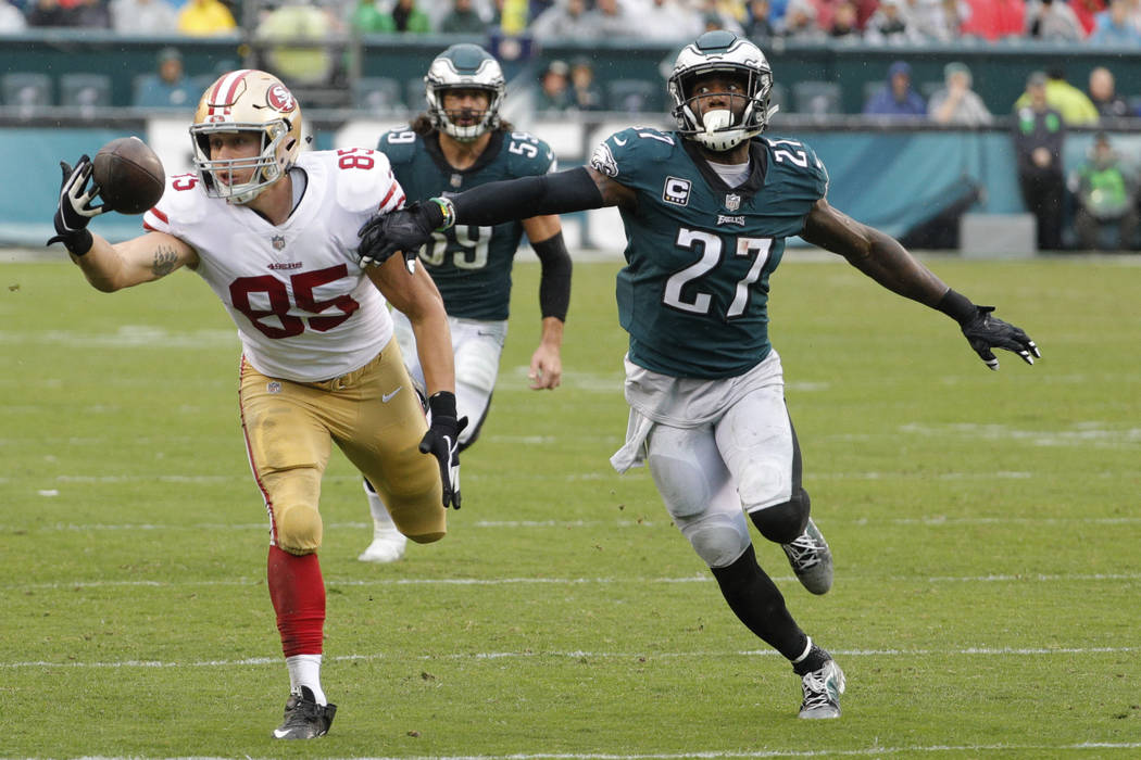 San Francisco 49ers tight end George Kittle, left, tries to catch the ball as Philadelphia Eagles strong safety Malcolm Jenkins, right, is defending during an NFL football game, Sunday, Oct. 29, 2 ...