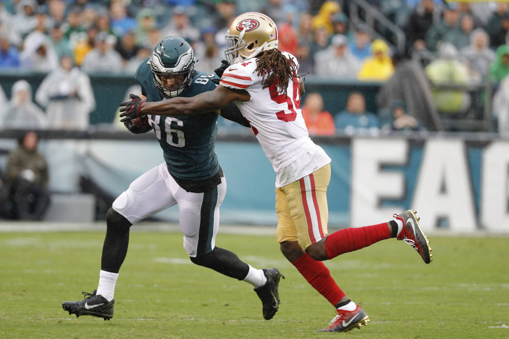 Philadelphia Eagles tight end Zach Ertz in action against San Francisco 49ers outside linebacker Ray-Ray Armstrong during an NFL football game, Sunday, Oct. 29, 2017, in Philadelphia. (AP Photo/Ch ...