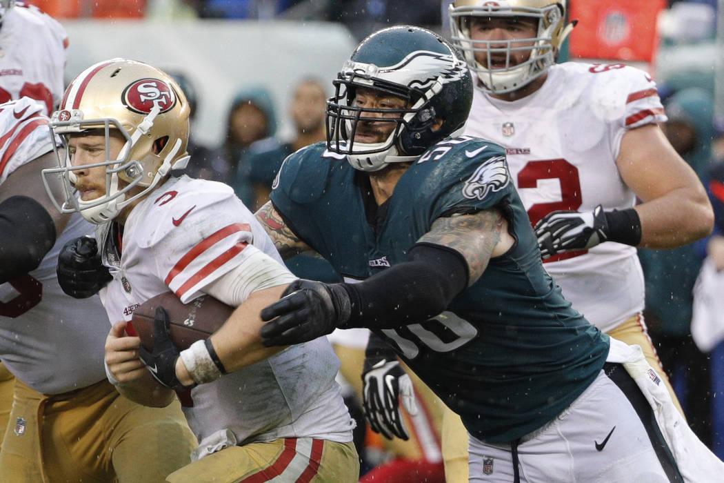Philadelphia Eagles defensive end Chris Long reaches for San Francisco 49ers quarterback C.J. Beathard during an NFL football game, Sunday, Oct. 29, 2017, in Philadelphia. (AP Photo/Chris Szagola)