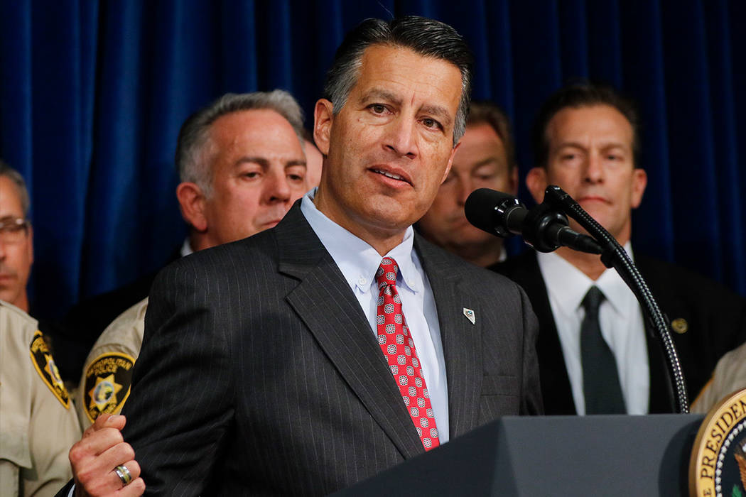 Gov. Brian Sandoval speaks at Metropolitan Police Department headquarters in Las Vegas on Wednesday, Oct. 4, 2017. A gunman opened fire on attendees of a music festival Sunday night, resulting in  ...