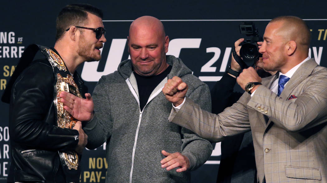 UFC middleweight champion Michael Bisping and Georges St-Pierre stare each other down at the UFC 217 news conference at Madison Square Garden in New York, New York, Thursday, Nov. 2, 2017. Heidi F ...