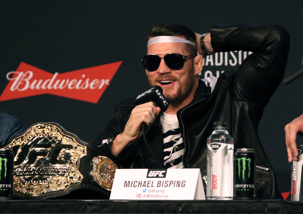 UFC middleweight champion Michael Bisping mocks Georges St-Pierre, not pictured, at the UFC 217 news conference at Madison Square Garden in New York, New York, Thursday, Nov. 2, 2017. Heidi Fang L ...
