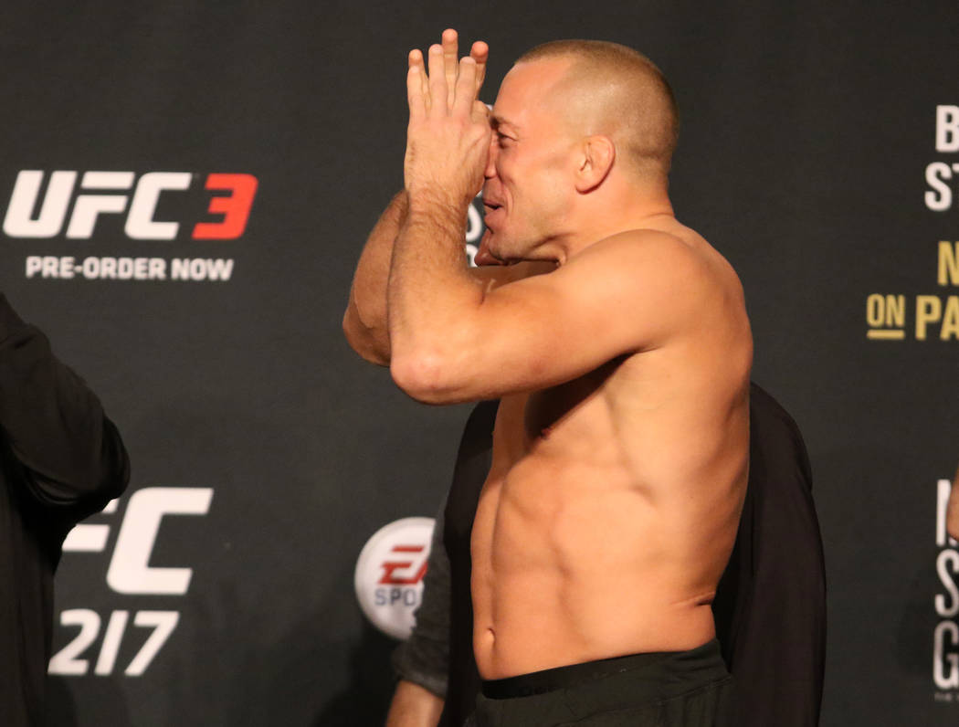 Georges St-Pierre mocks Michael Bisping, not pictured, at the UFC 217 ceremonial weigh-in at the Madison Square Garden theater in New York, New York, Friday, Nov. 3, 2017. Heidi Fang Las Vegas Rev ...