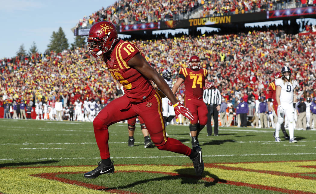 Iowa State wide receiver Hakeem Butler (18) celebrates after catching a 4-yard touchdown pass during the first half of an NCAA college football game against TCU, Saturday, Oct. 28, 2017, in Ames,  ...