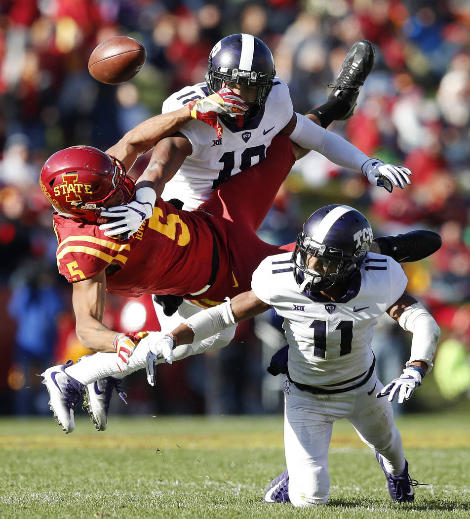 TCU safety Nick Orr (18) and cornerback Ranthony Texada (11) break up a pass intended for Iowa State wide receiver Allen Lazard (5) during the first half of an NCAA college football game, Saturday ...