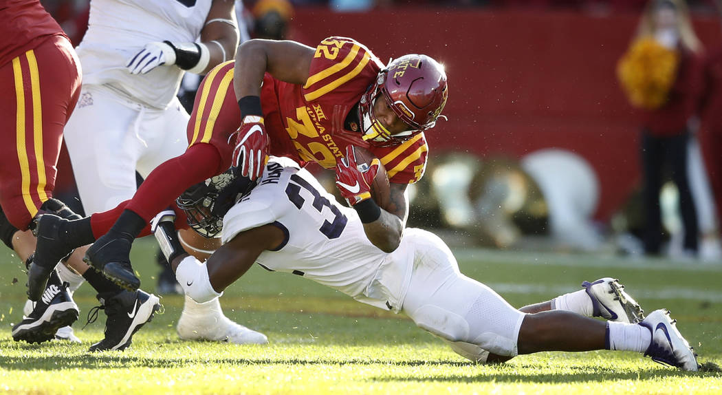 Iowa State running back David Montgomery (32) is tackled by TCU linebacker Travin Howard during the second half of an NCAA college football game, Saturday, Oct. 28, 2017, in Ames, Iowa. Iowa State ...
