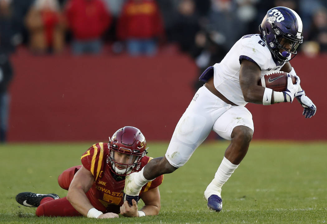 TCU running back Darius Anderson runs from Iowa State linebacker Joel Lanning, left, during the second half of an NCAA college football game, Saturday, Oct. 28, 2017, in Ames, Iowa. Iowa State won ...