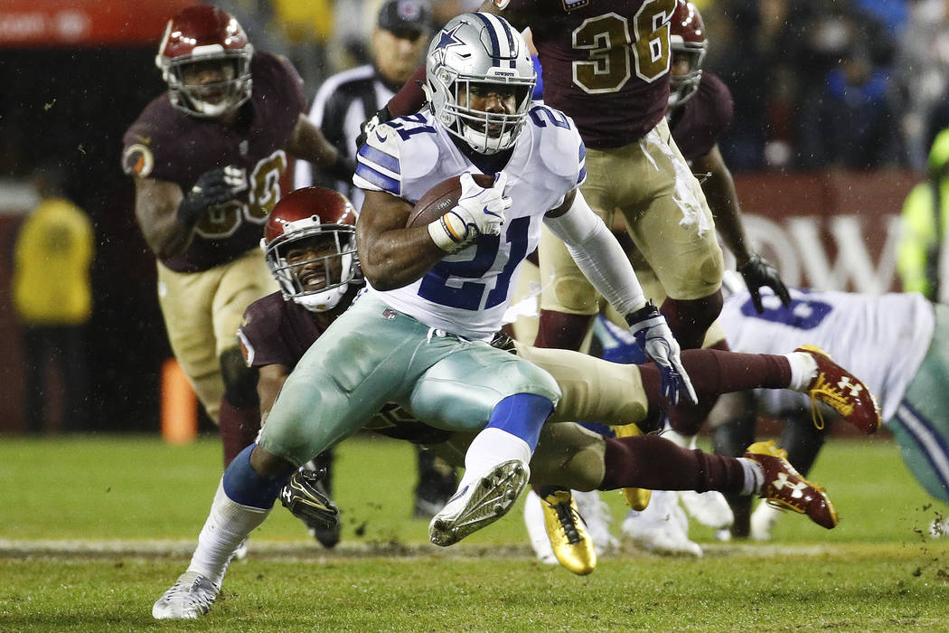 Dallas Cowboys running back Ezekiel Elliott (21) carries the ball during the second half of an NFL football game against the Washington Redskins in Landover, Md., Sunday, Oct. 29, 2017. (AP Photo/ ...