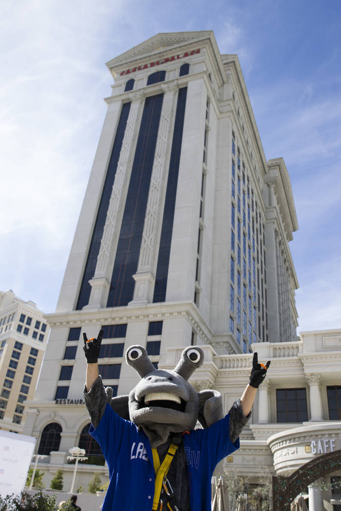 Cosmo from the Las Vegas 51s after rappelling from the Caesars Palace Augustus Tower in Las Vegas, Friday, Nov. 3, 2017. Olive Crest is hosting the Drop to Stop Child Abuse event to bring awarenes ...
