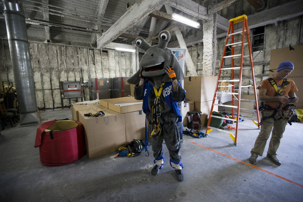 Cosmo from the Las Vegas 51s gets ready to rappel from the Caesars Palace Augustus Tower in Las Vegas, Friday, Nov. 3, 2017. Olive Crest is hosting the Drop to Stop Child Abuse event to bring awar ...