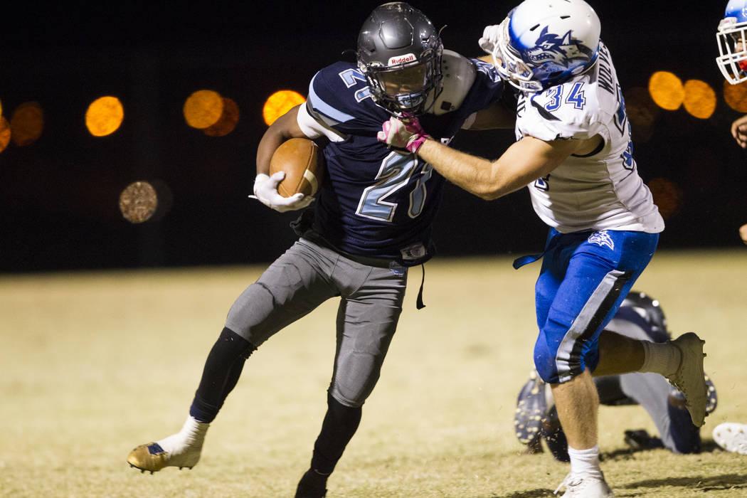 Canyon Spring's DiaMante Burton (2) runs the ball against Basic's Trace Evans (34) in the playoff football at Canyon Spring High School in Las Vegas, Friday, Nov. 3, 2017. Erik Verduzco Las Vegas  ...