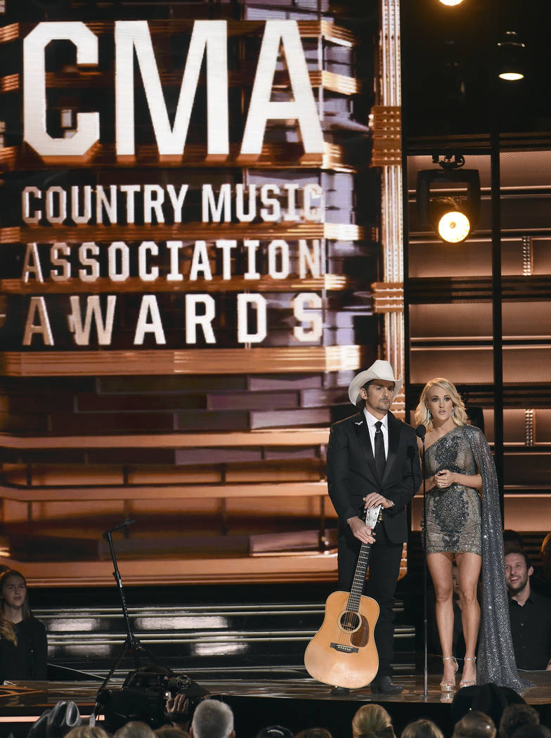 This Nov. 2, 2016 file photo shows hosts Brad Paisley, left, and Carrie Underwood at the 50th annual CMA Awards in Nashville, Tenn.  (Photo by Charles Sykes/Invision/AP, File)