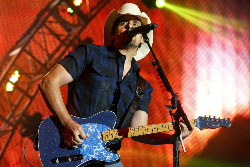 In this June 27, 2015 file photo, Brad Paisley performs during day two of the 2015 FarmBorough Music Fest in New York. Paisley, the co-host of the Country Music Association Awards, called on the o ...