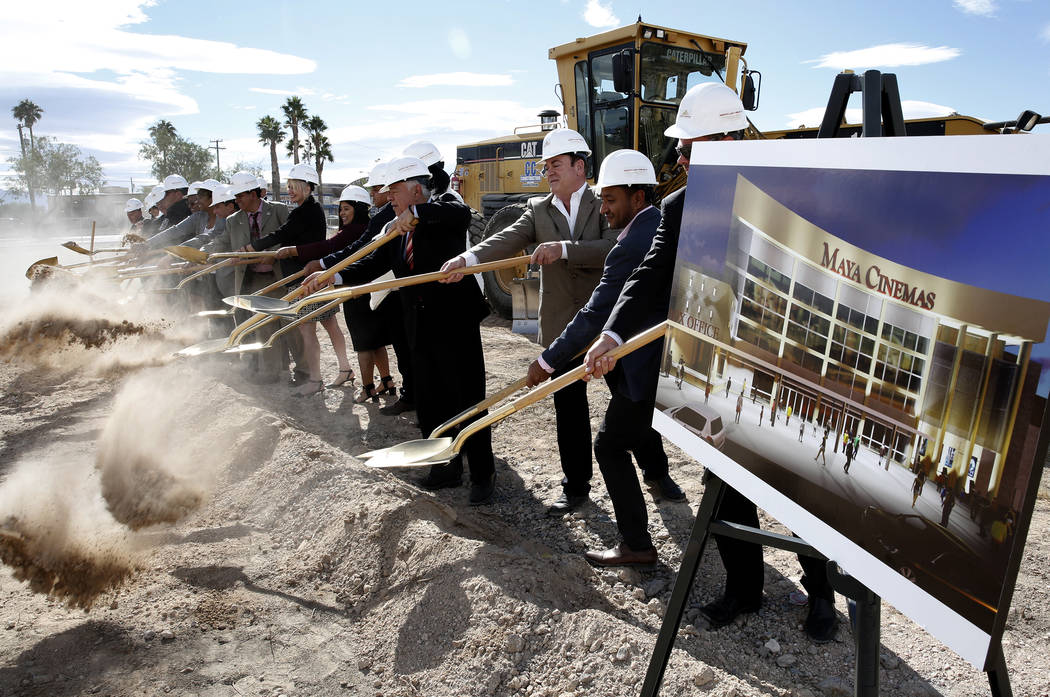 The city of North Las Vegas and Maya Cinemas officials turn shovels during the official groundbreaking ceremony for the construction of a 14-screen Maya Cinemas and entertainment center at 2195 La ...