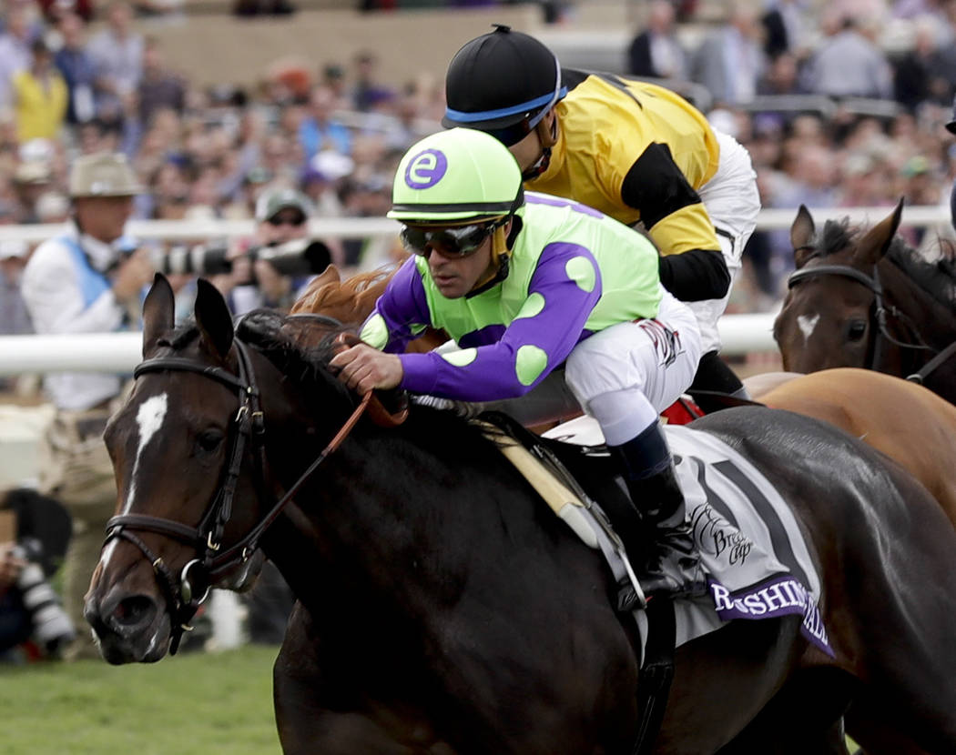 Jockey Javier Castellano rides Rushing Fall to victory in the Juvenile Fillies Turf horse race during the first day of the Breeders' Cup, Friday, Nov. 3, 2017, in Del Mar, Calif. (AP Photo/Gregory ...