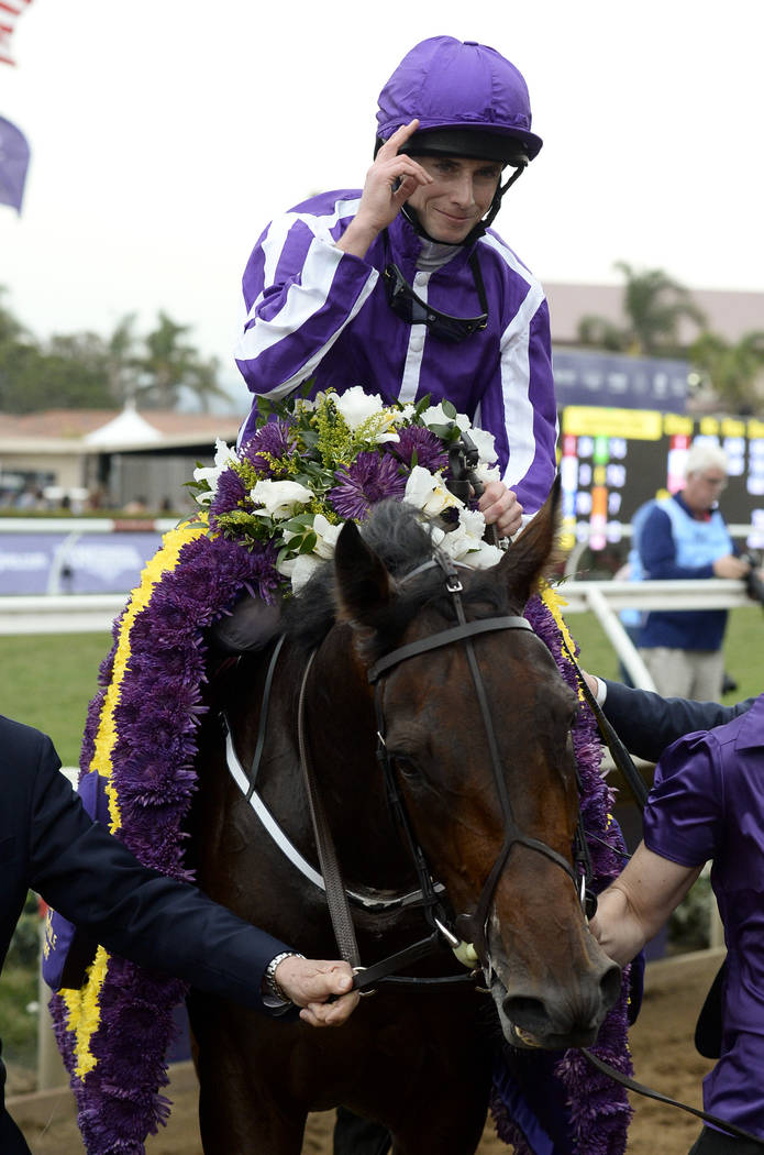 Ryan L. Moore, top, celebrates after riding Mendelssohn, bottom, to victory in the Juvenile Turf horse race during the first day of the Breeders' Cup, Friday, Nov. 3, 2017, in Del Mar, Calif. (AP  ...
