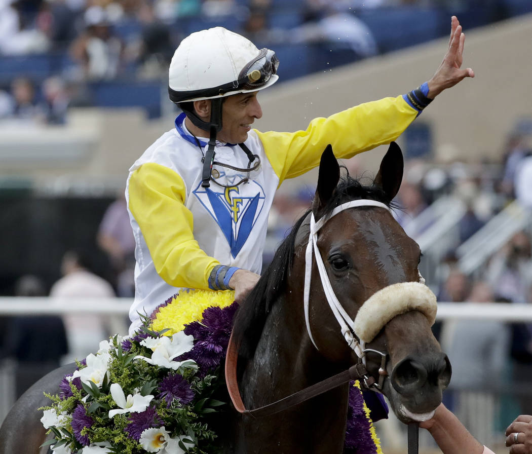 John R. Velazquez, top, celebrates after riding Forever Unbridled to victory in the Longines Distaff horse race during the first day of the Breeders' Cup, Friday, Nov. 3, 2017, in Del Mar, Calif.  ...