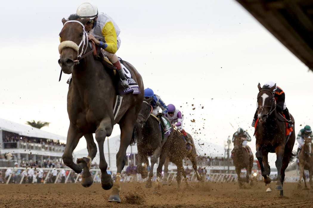 Forever Unbridled, left, with John R. Velazquez aboard, wins the Longines Distaff horse race during the first day of the Breeders' Cup, Friday, Nov. 3, 2017, in Del Mar, Calif. (AP Photo/Gregory Bull)