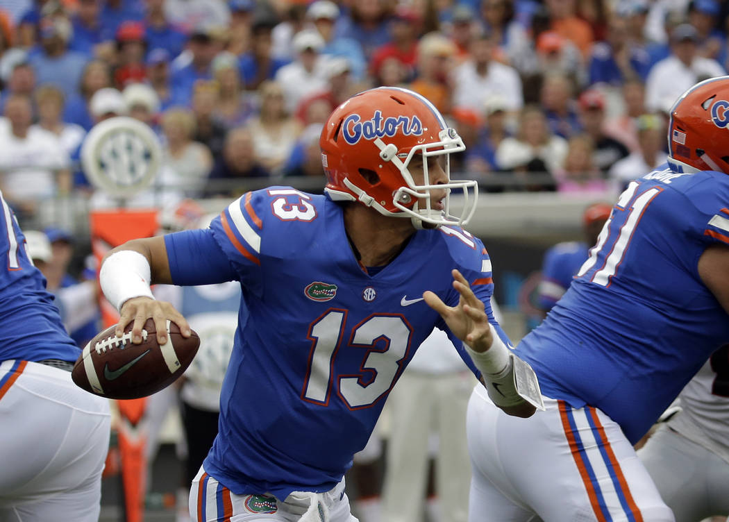 Florida quarterback Feleipe Franks looks for a receiver in the first half of an NCAA college football game, Saturday, Oct. 28, 2017, in Jacksonville, Fla. (AP Photo/John Raoux)