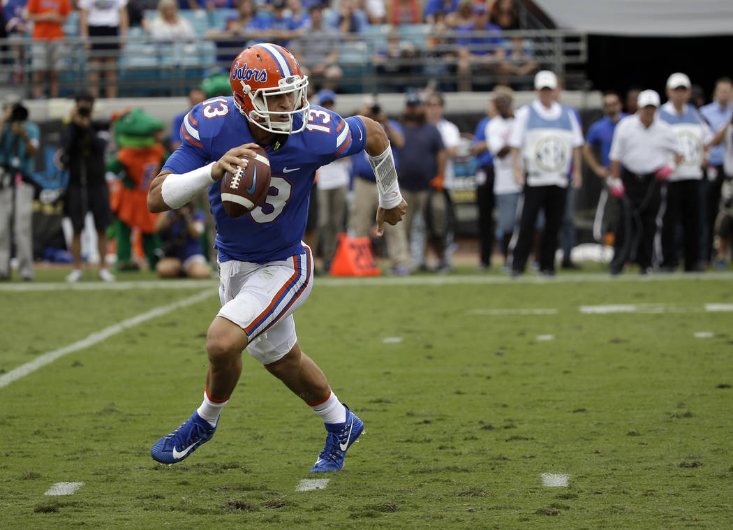 Florida quarterback Feleipe Franks looks for a receiver against Georgia in the first half of an NCAA college football game, Saturday, Oct. 28, 2017, in Jacksonville, Fla. (AP Photo/John Raoux)