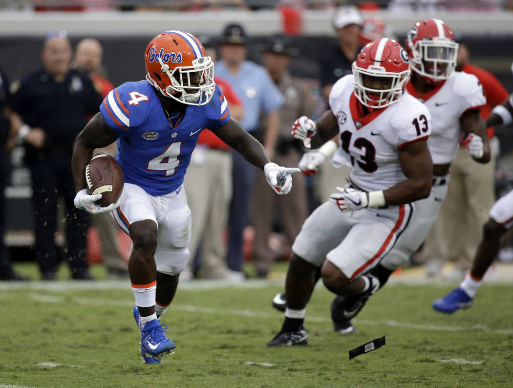 Florida wide receiver Brandon Powell (4) runs for yardage past Georgia defensive end Jonathan Ledbetter (13) in the second half of an NCAA college football game, Saturday, Oct. 28, 2017, in Jackso ...