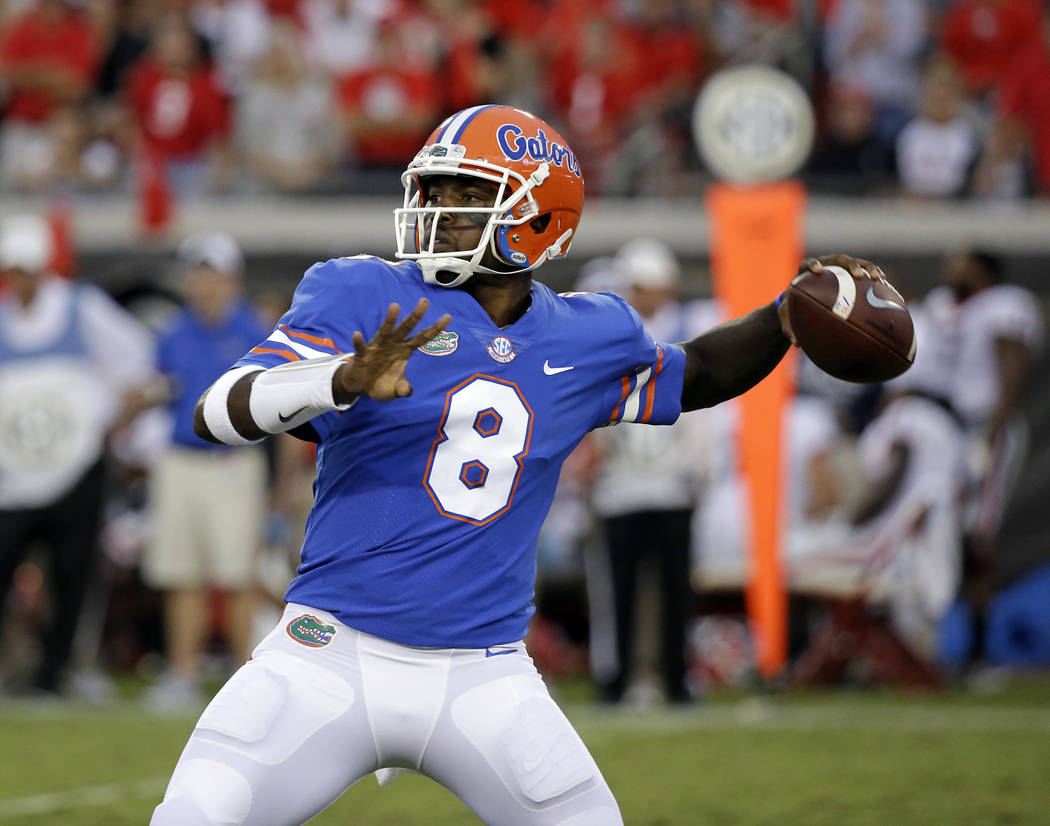Florida quarterback Malik Zaire looks for a receiver against Georgia in the second half of an NCAA college football game, Saturday, Oct. 28, 2017, in Jacksonville, Fla. Georgia won 42-7. (AP Photo ...