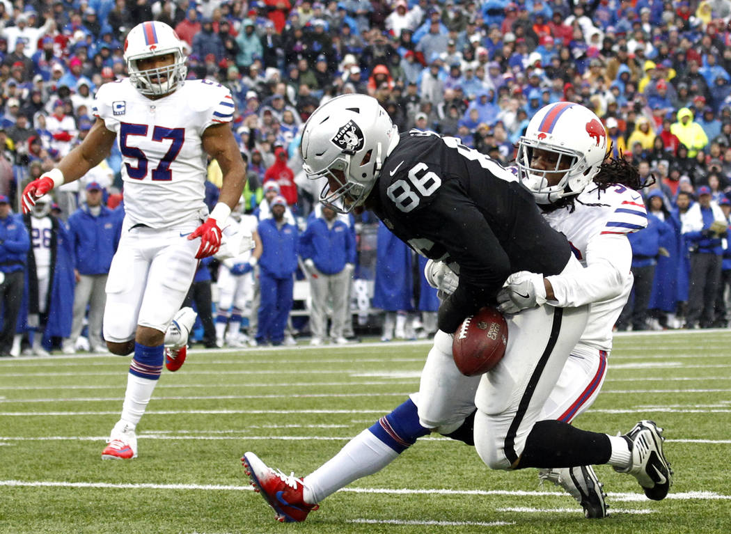 Oakland Raiders tight end Lee Smith (86) is able to hold on to the ball after making a catch against Buffalo Bills defensive back Trae Elston (36) during the first half of an NFL football game, Su ...