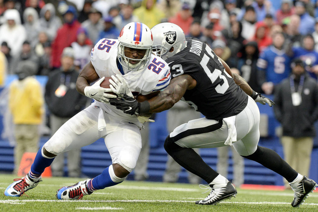 Buffalo Bills running back LeSean McCoy (25) is tackled by Oakland Raiders middle linebacker NaVorro Bowman (53) during the second half of an NFL football game, Sunday, Oct. 29, 2017, in Orchard P ...