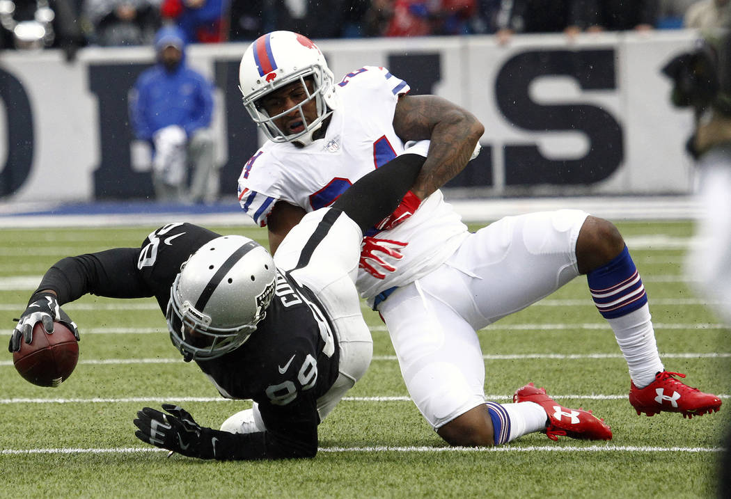 Oakland Raiders wide receiver Amari Cooper (89) is tackled by Buffalo Bills defensive back Leonard Johnson (24) during the first half of an NFL football game, Sunday, Oct. 29, 2017, in Orchard Par ...