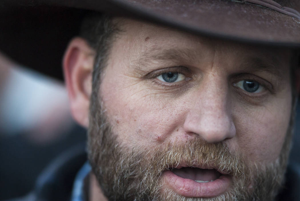 Ammon Bundy speaks with reporters after meeting with Harney County Sheriff Dave Ward, at the Malheur National Wildlife Refuge headquarters near Burns, Ore. on Thursday, Jan. 7, 2016.  (Chase Steve ...