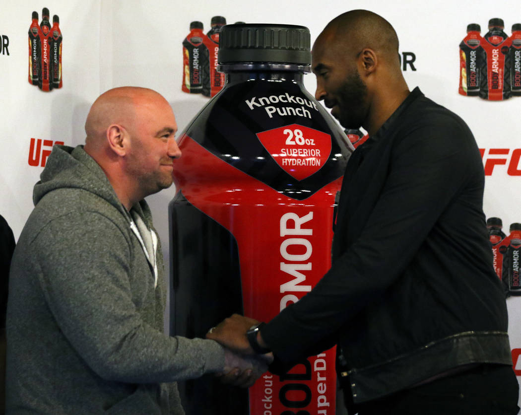 UFC president Dana White shakes hands with retired NBA superstar Kobe Bryant during a Body Armor event during UFC 217 fight week in New York, New York, Thursday, Nov. 2, 2017. Heidi Fang Las Vegas ...