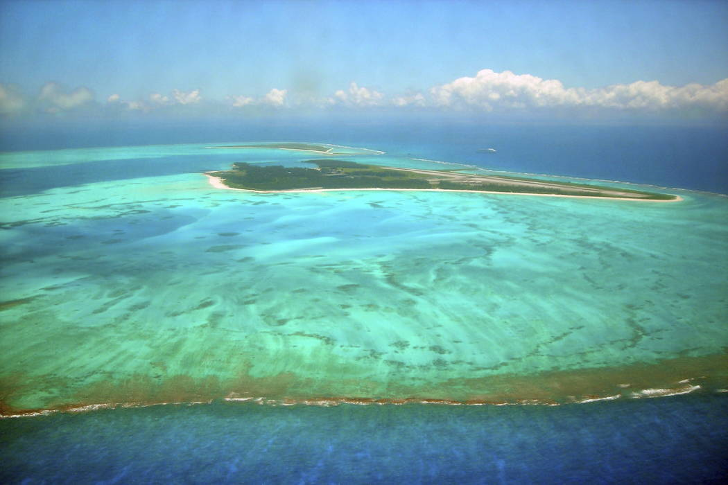 Midway Atoll, which has long stretches of pristine atolls and coral reefs, is seen in 2007. (Burl Burlingame, Honolulu Star-Bulletin via AP, file)