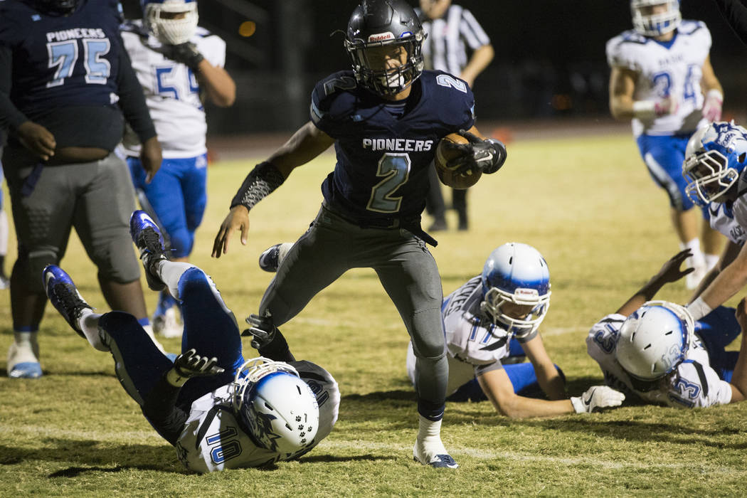 Canyon Spring's DiaMante Burton (2) runs the ball for a touchdown against Basic's Franco Mays (10) during their playoff football game at Canyon Spring High School in Las Vegas, Friday, Nov. 3, 201 ...