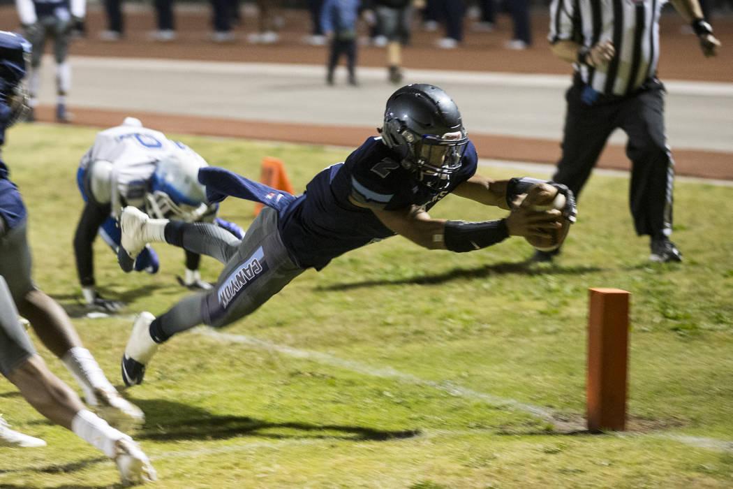 Canyon Spring's DiaMante Burton (2) runs the ball for a touchdown against Basic during their playoff football game at Canyon Spring High School in Las Vegas, Friday, Nov. 3, 2017. Erik Verduzco La ...