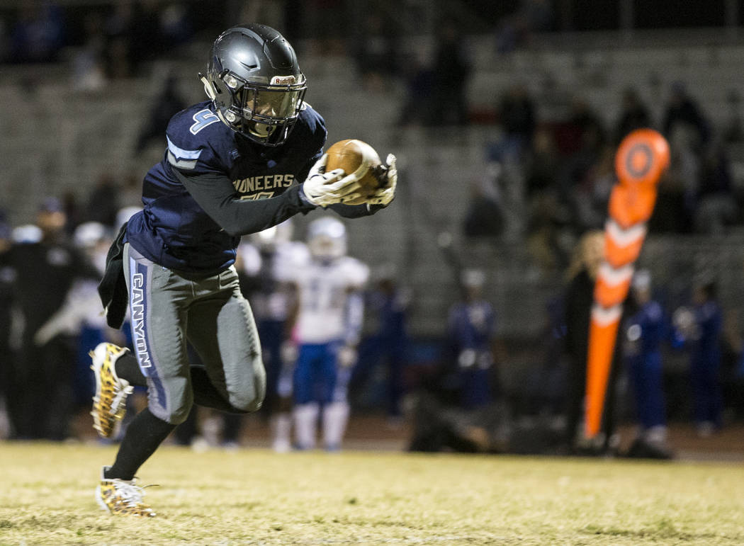 Canyon Spring's Kazonte Thomas (4) runs the ball for a touchdown against Basic during their playoff football game at Canyon Spring High School in Las Vegas, Friday, Nov. 3, 2017. Erik Verduzco Las ...