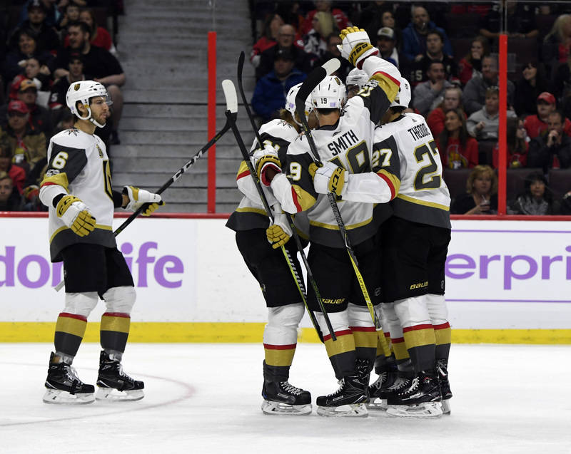Nov 4, 2017; Ottawa, Ontario, CAN; Vegas Golden Knights forward Alex Tuch (89) reacts with teammates  including Reilly Smith (19) and Shea Theodore (27) after scoring a goal against the Ottawa Sen ...
